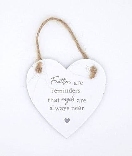Feathers are reminders that angels are always near wooden heart sign